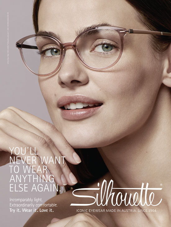 a model wears designer eyeglasses while looking into the camera